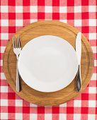 kitchen utensils at cutting board on napkin background