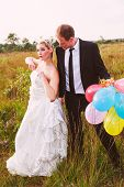 Funny wedding couple with balloons