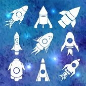 Vector white rockets icons on watercolor background