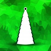 Abstract Christmas tree with green polygonal background