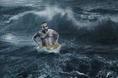 Man in the sea while storming