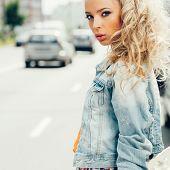 Beautiful Blonde Woman On The Street