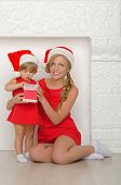 Beautiful Woman With Child In Santa Costumes