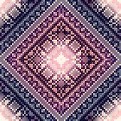 Cross-stitch pattern on blurred background