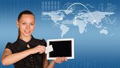 Beautiful businesswoman in dress holding tablet and white empty card near screen of tablet. World ma