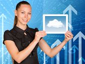 Beautiful businesswoman holding tablet with clouds on screen. Arrows and figures