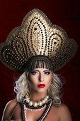Russian Beauty. Attractive female wearing in kokoshnik. Woman's headdress in old Russia
