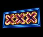 XXX neon sign illuminated over dark background