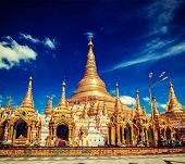 Vintage retro effect filtered hipster style image of Myanmer famous sacred place and tourist attraction landmark - Shwedagon Paya pagoda. Yangon, Myanmar