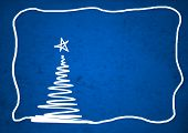 Conceptual blue old paper background, made of grungy or vintage texture stained or dirty surface for holiday, Christmas a white conceptual fir tree and a border or frame