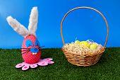 Easter theme: Bunny egg on garden with basket