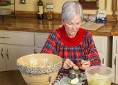 Senior Lady Preparing Pie