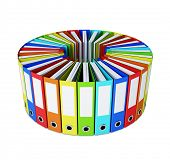 Multicolored folders forming a circle on white