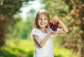 Little girl with grapes