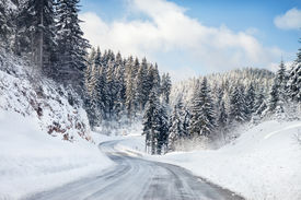 stock photo of slippery-roads  - Empty snow covered road - JPG