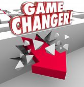 Постер, плакат: Game Changer words in red 3d letters on a maze wall and an arrow breaking through to illustrate a ne