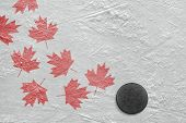 stock photo of hockey arena  - Hockey puck and a schematic representation of the Canadian flag - JPG