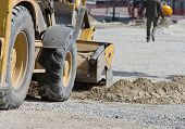 stock photo of sand gravel  - Close up of bulldozer loading sand on road construction site - JPG
