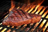 picture of grill  - Beef Strip Steak On The Flaming Hot Barbecue Grill - JPG