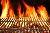 stock photo of braai  - Flame Fire Empty Hot Barbecue Charcoal Grill With Glowing Coals On Black Background - JPG