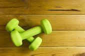 foto of light weight  - Light dumbbells for fitness on the wooden floor - JPG