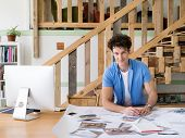 image of draft  - Man working with drafts in office - JPG