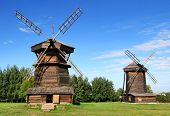 stock photo of household farm  - Two old wooden windmills in Suzdal - JPG