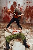 Постер, плакат: Bloody Maniac With The Axe Is Going To Kill A Victim