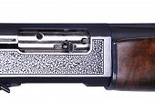 pic of shotgun  - Detail of a shotgun and bullets isolated on white background - JPG