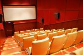 picture of cinema auditorium  - Empty small Cinema Auditorium with beige Chairs - JPG