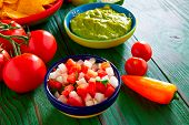picture of nachos  - Mexican food nachos guacamole pico de gallo and chili peppers sauces - JPG