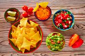 pic of nachos  - Mexican food mixed guacamole nachos chili sauce dipping cheddar cheese lemon pico de gallo - JPG