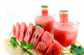 stock photo of watermelon slices  - Cut watermelon slices with glasses of juice - JPG