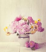 picture of chrysanthemum  - Retro still life with colourful chrysanthemums bunch on old  wooden board - JPG