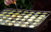 picture of quail  - A street vendor cooks poached quail eggs a popular snack in Taiwan - JPG