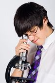 Boy With Microscope
