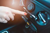Woman Turns On Air Conditioning In Her Car poster