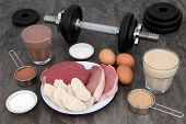 High protein food of meat and eggs with health drinks for body builders with weight training dumbbel poster