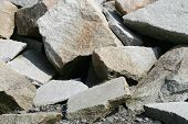 stock photo of fieldstone-wall  - Old crumbled stones and rocks on a shale floor - JPG