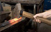 hands at work in blacksmithy
