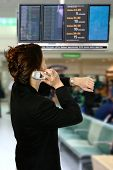 Asian Businesswoman In Airport With Phone