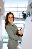 Businesswoman In Corporate Setting, With Files