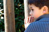 Boy Listening To Hanging Music Blocks At Park