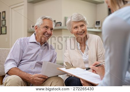 poster of Senior couple meeting real estate agent at home. Old husband and wife with financial advisor for inv