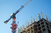 Construction Crane In The Process Of Building A New Residential Building. Construction Of An Apartme poster