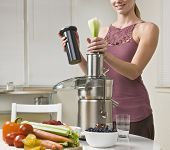 picture of juicer  - Attractive woman with juicer machine - JPG
