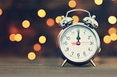 Midnight Clock And Blurred Lights In Background. New Years Countdown poster