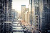 Filtered Image Of Chicago Riverside Skylines At Sunset poster