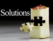 stock photo of solution problem  - Deliciously juicy cut apple with puzzule piece - JPG