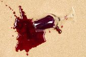 A glass of spilled wine on brand new carpet is sure to leave a stain.